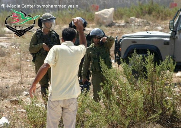 A demonstrator confronting soldiers (Photo by Mohammed Yasin)