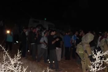 Illegal settlers and Israeli army invading Sarta (photo by Nima Musleh)