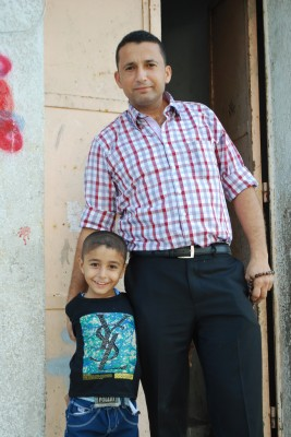 A father and son in their Eid clothes. (Photo by Charlie Andreasson)