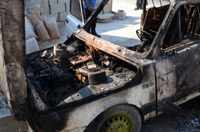 The family car after it was set on fire (Photo by ISM)