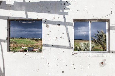"The ""buffer zone"" is seen from the second floor of Nasser Abu Said's house in Jahr el-Deek. On 28 April 2011 the house, which stands 300 meters from the separation barrier, was shelled by Israeli tanks and partially destroyed. (Photo by Desde Palestina)"