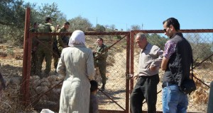 Israeli soldiers force Palestinians from their land with a supposed military order