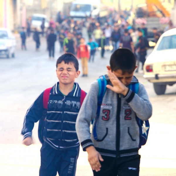 Two school children suffer from the effects of tear gas