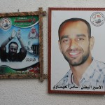 Posters of Samer Issawi and Marwan Barghouthi hang inside the Red Cross. (Photo by Joe Catron)