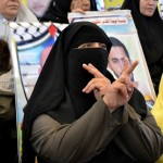 A woman rallies for Palestinian detainees and martyrs in Gaza. (Photo by Rosa Schiano)
