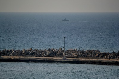 An Israel naval gunship cruises near the Gaza seaport on Wednesday, 13 November. (Photo by Rosa Schianp)