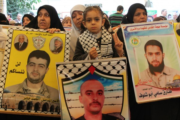 Families and supporters of Palestinian detainees gather in the Red Cross' Gaza courtyard every Monday morning. (Photo by Joe Catron)
