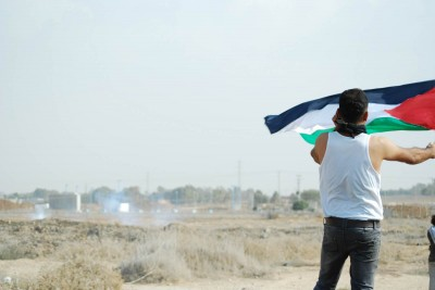 Palestinians demonstrate in the buffer zone East of Gaza City on the anniversary of the signing of the Balfour Declaration. (Photo by ISM Gaza)