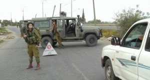 Israeli soldiers and the flying checkpoint outside the village