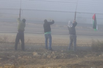 Palestinian activists began to cut down the annexation fence (photo by Ingrid Bousquet)