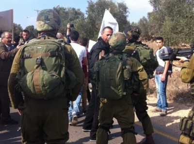 Israeli forces attempt to end the peaceful demonstration (photo by ISM).