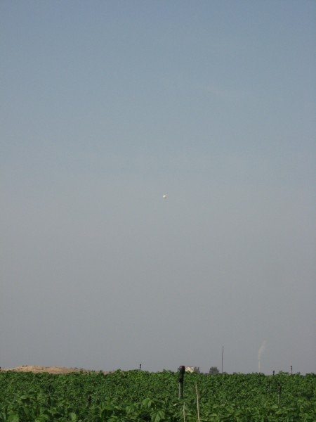 An Israeli surveillance balloon was hovering above farmers working in Beit Hanoun in the 'buffer' area – 6/11/13.