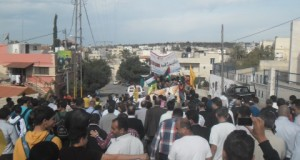 Protesters march through the village