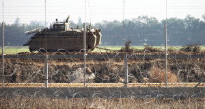 An Israeli military vehicle by the separation barrier near Khuza'a. (Photo by Silvia Todeschini)
