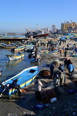 Fisherman and their boats in the Gaza seaport. (Photo by Rosa Schiano)