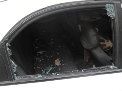 A broken car window, the result of illegal settlers throwing stones (photo by ISM).