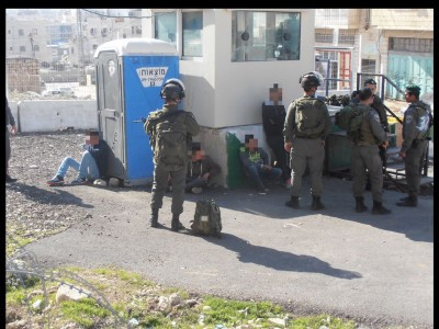 Four youth detained by the checkpoint ( Photo via ISM archives)