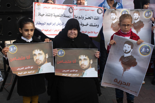 Umm Muhammad, the mother of critically ill prisoner Ibrahim Bitar, with two of his neices at a weekly sit-in. She hasn't seen her son in more than three months. (Joe Catron)