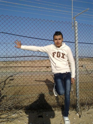 Belal Samir Ahmed 'Aweidah, shortly before he was shot and killed by an Israeli military sniper. (Photo by Akram 'Aweidah)
