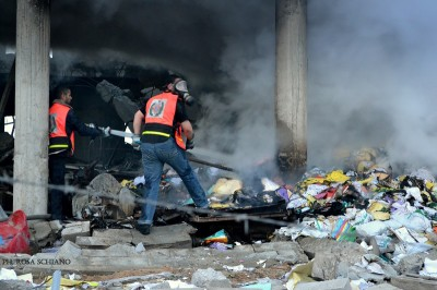 Civil Defense crews work to clear the rubble left by an Israeli airstrike on 31 January. (Photo by Rosa Schiano)