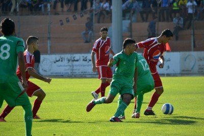 A football match in Yarmouk stadium. (Photo by Rosa Schiano)