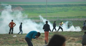 Israeli forces fire tear gas at Palestinian demonstrators during the Jabaliya protest on 21 February. (Photo by Charlie Andreasson)