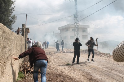 Protesters surrounded by tear gas (Photo by ISM)