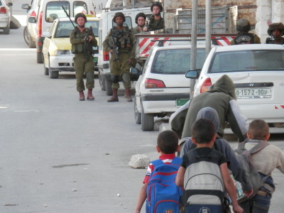 Israeli soldiers close to a school in Hebron (photo by ISM)