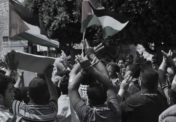 Protesters march handcuffed through the streets of Nablus