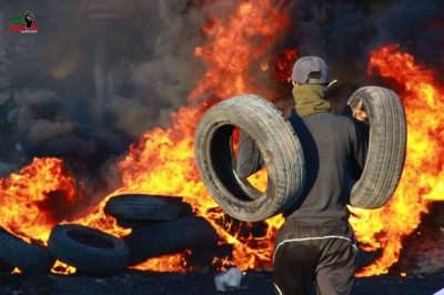 Tyre barricade in Kafr Qaddum, 12th May 2014, after the arrests. Photo by Al Masira Kufr Qaddum