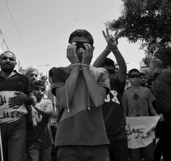 Many children participated in the march, handcuffed and blindfolded to symbolize the brutality of Israeli authorities. (Photo by ISM)