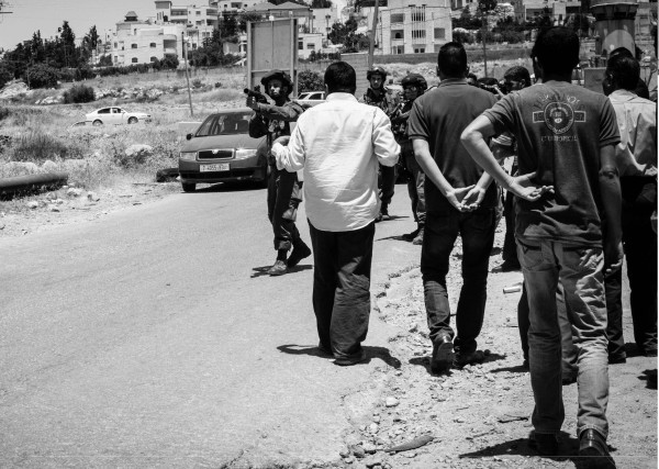 Throughout the protest the soldiers were firing tear gas, some grenades aimed directly towards the protesters. Being hit by a tear gas canister in the head or other parts of the body, can be fatal. (Photo by ISM)