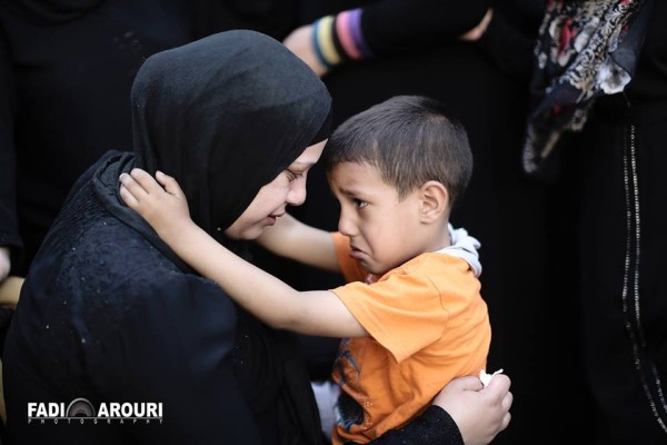 Mahmoud's wife and son (photo by Fadi Arouri).