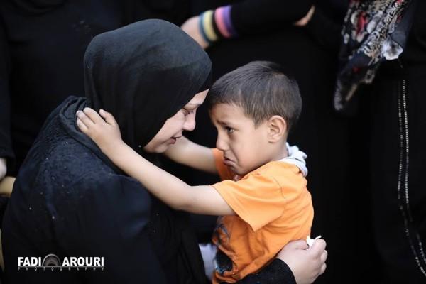 Mahmoud's wife and son (photo by Fadi Arouri).