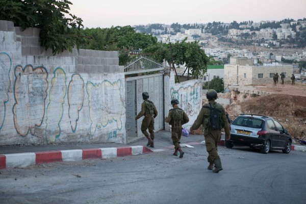 Israeli soldiers entering a home in Qeitun (photo by ISM).