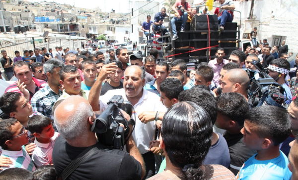 Ahmad Arafat Sabareen's father speaks of his son at the funeral (photo by Middle East Monitor).