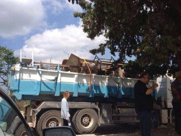 Confiscated belongings loaded into an Israeli truck. (Photo by witness)