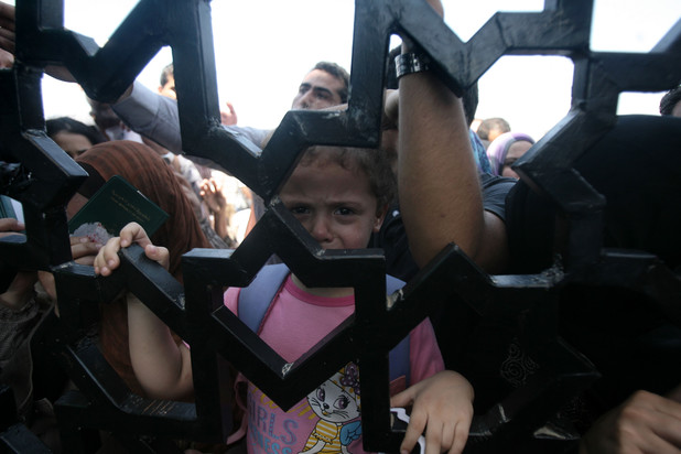 Palestinian-Egyptians wait to enter the Rafah border crossing, the only border through which Palestinians can exit Gaza