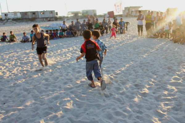 Young relatives of four children killed by Israeli shelling while playing football on a beach in July play their game that was violently cut short, 7 September (Joe Catron)