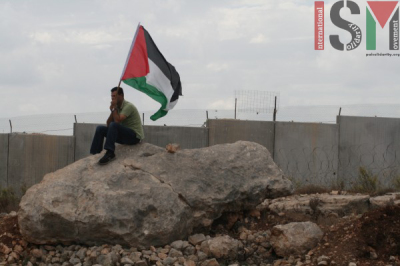 Abdallah at a demonstration in Bil'in on November 9th, 2012.