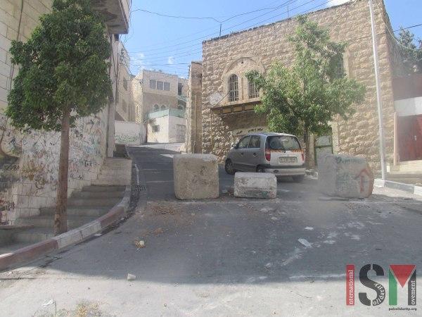 A closed road in Qeitun.