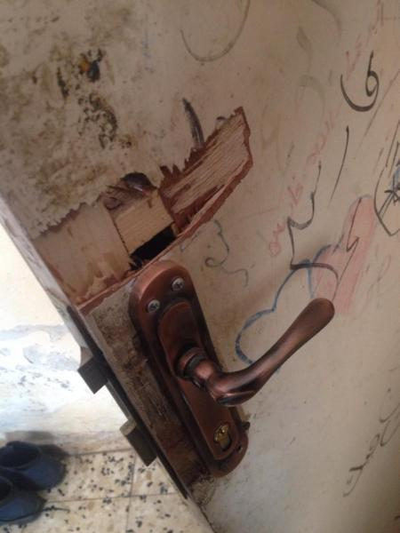 A broken handle left over from the night raid (photo by ISM).