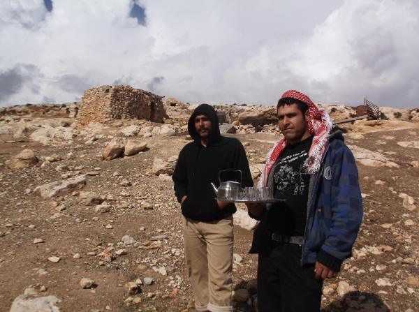 Sofian Maher and local resident near their destroyed home near Khirbet Al-Tawil