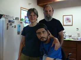 Tristan with his parents, Mike and Nancy Anderson in their home in Grass Valley, California.