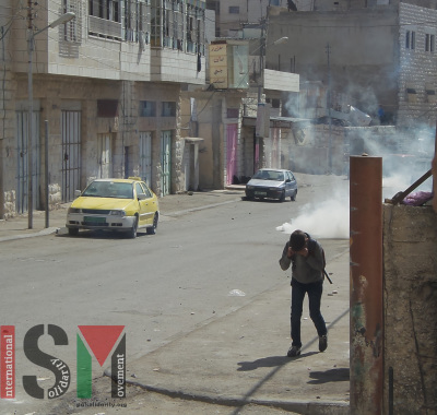 A child trying to escape tear gas fired by the Israeli military close to several schools on October 13th in the Salaymeh neighbourhood of Hebron