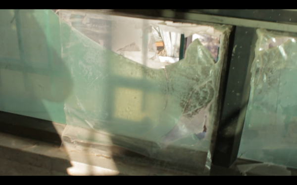 Window broken during Israeli army nigh raid (photo by ISM).