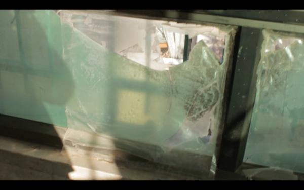 Window broken during Israeli army nigh raid (photo by ISM).