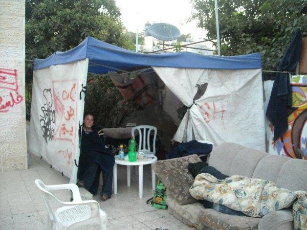 Kayla sitting in a protest tent in Sheikh Jarrah - Photo by
