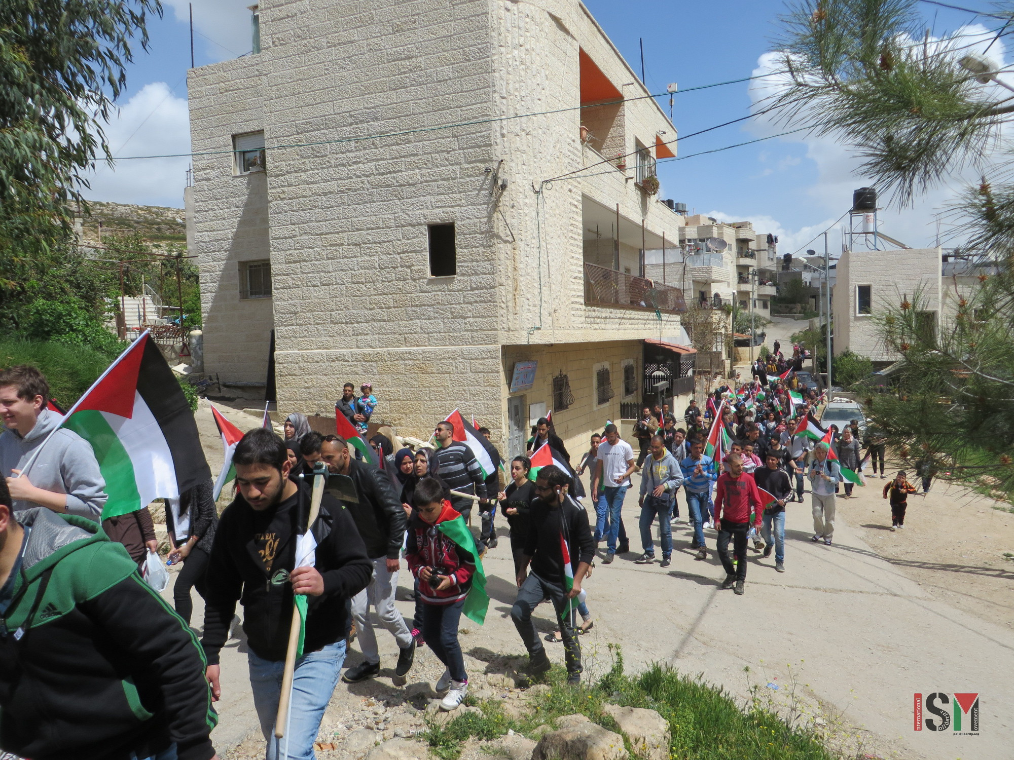 Land Day protest marching in the streets of Wadi Fukin