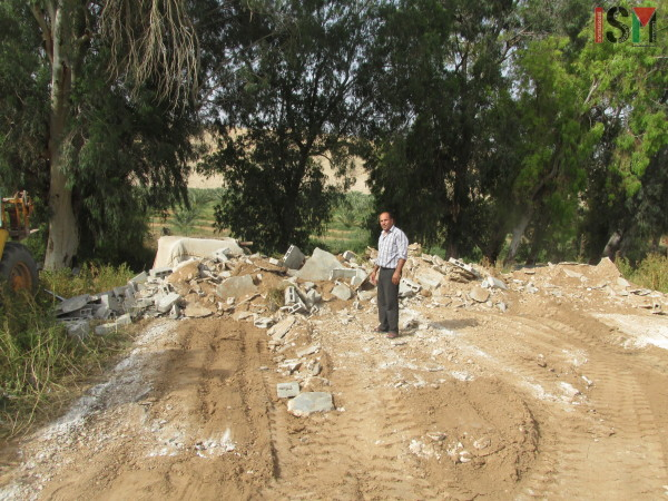 Mahmod Lahafe Dadoub on the spot where his family's home was.
